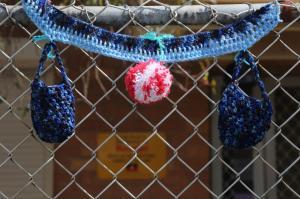 Pom pom on the fence