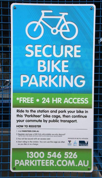Parkiteer sign on bike cage