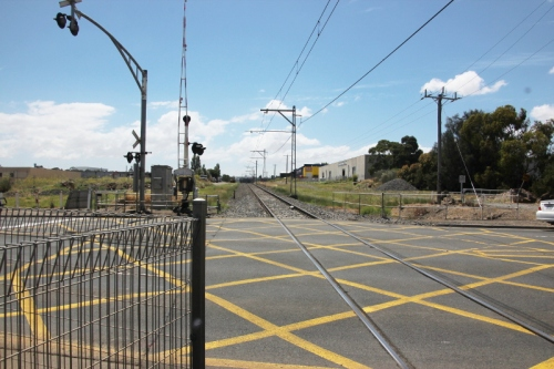 Looking north up the railway line at Camp Rd Level Crossing